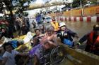 A disabled person is evacuated after floods advanced into her neighborhood in central Bangkok, Oct. 25, 2011. REUTERS/Damir Sagolj